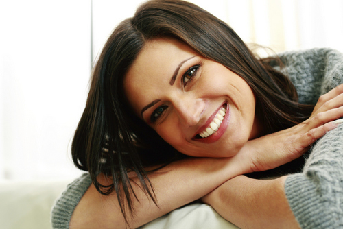 Garden City, NY woman smiling about the restorative procedure she received from her dentist.